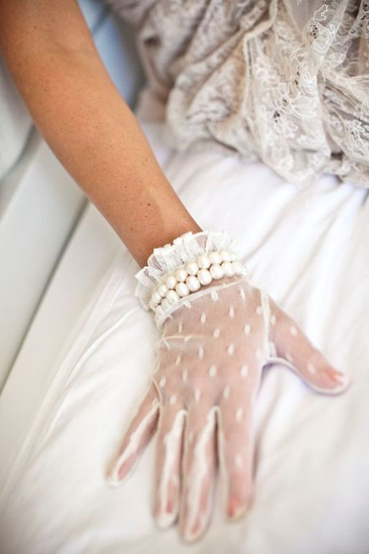 white lace gloves with two rows of pearls look chic and accented and will be a gorgoeus vintage wedding accessory