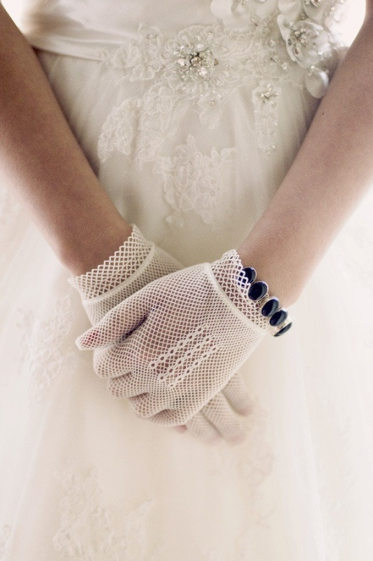 net lace gloves and a purple rhinestone bracelet will accent your vintage outfit adding a bit of color to it