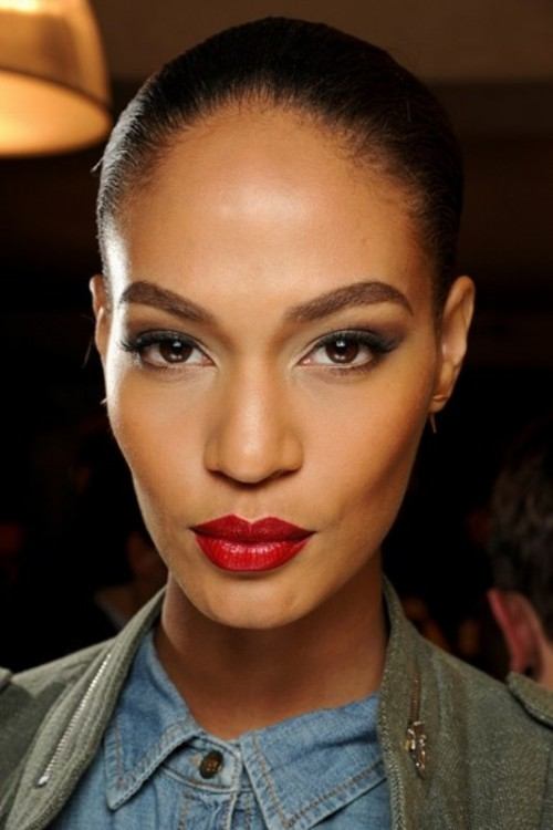 a bold and statement makeup with a red lip and chic smokey eyes that don't stand out too much