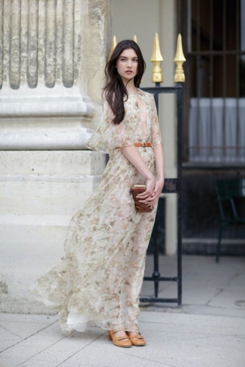 a neutral floral print A-line wedding dress with short sleeves and a plunging neckline is very flowy and airy