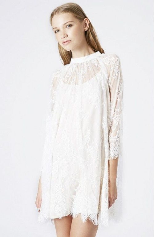 a lace mini dress with a plain underdress, long sleeves and a high illusion neckline for a boho bride