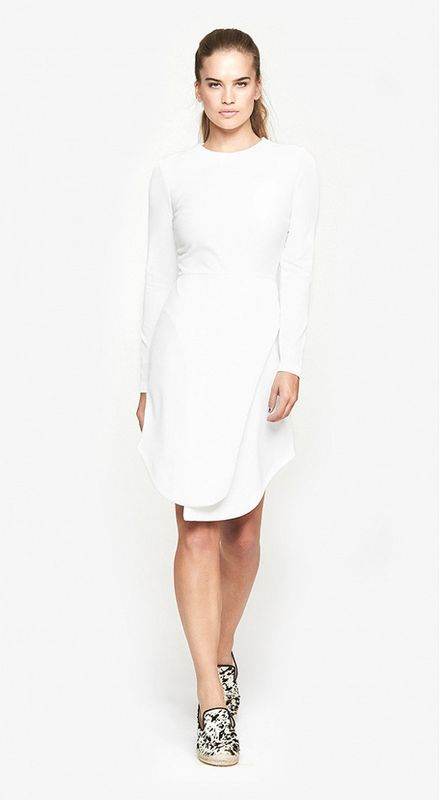 an ultra-minimalist white plain over the knee wedding dress with a high neckline and long sleeves for a minimalist bride