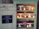 a vintage mint-colored cabinet with candles and chalkboard signs and pies on stands is a cool idea for a vintage or rustic wedding
