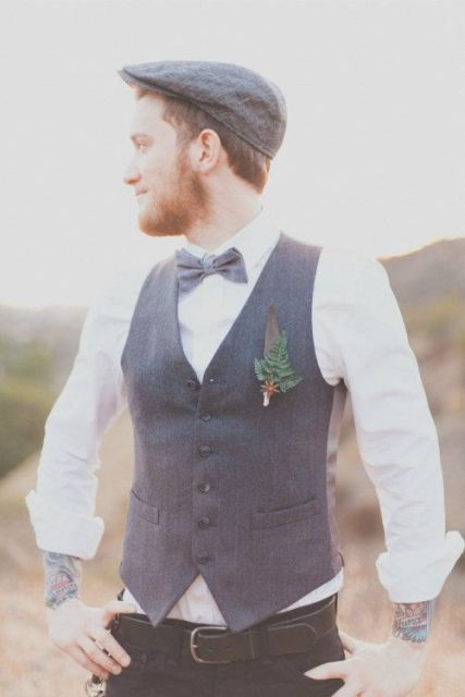 a vintage-inspired look with black pants, a grey waistcoat, a white shirt, a grey bow tie and a grey cap