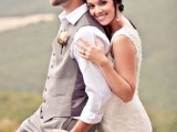 a vintage-inspired groom's look with grey pants and a waistcoat, a cap, a tie and a white shirt