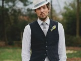 grey pants and a tie, a white shirt, a black waistcoat, a white shirt and a neutral hat