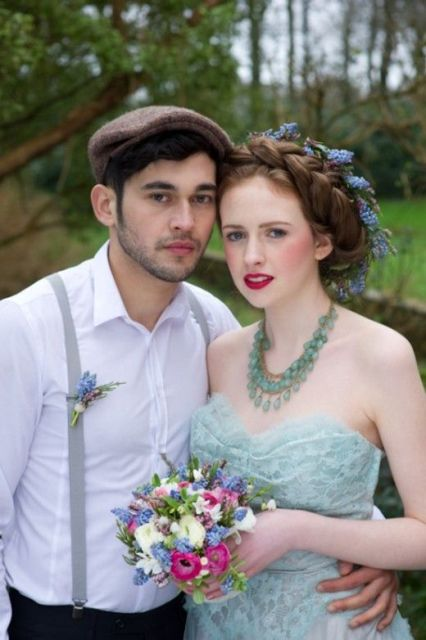 a vintage groom's look with dark pants, a white shirt, grey suspenders and a brown cap