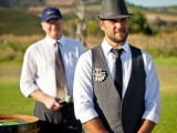 a rustic groom's look with black pants, a black waistcoat, a black tie, a black hat and a white shirt