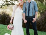 a rustic groom's look with navy jeans, brown shoes and a chambray shirt, suspenders and a cap