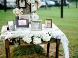 a real tree with family photos, large fabric blooms, a table with photos and blooms for a cozy family look