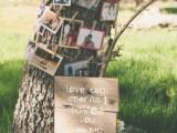 a real tree with lots of family photos attached to it, a sign for a summer wedding outside