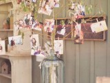 a summer family tree made of green branches put into a large bottle and lots of family photos attached to them