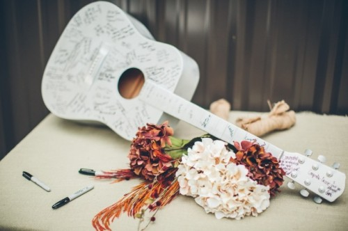 a white guitar as a wedding guest book is a lovely and unique idea thta can be used as decor after the wedding