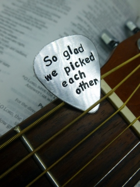 a flat pick with an engraving is a cool wedding favor idea that won't cost too much