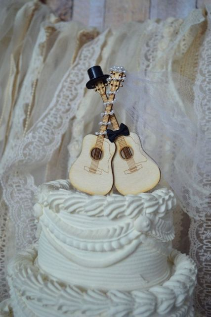 wood and bead guitar wedding cake toppers are amazing for topping it off and making it cooler