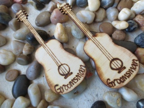 mini wood burnt guitar boutonnieres like these ones will make your groomsmen looks bolder and quirkier