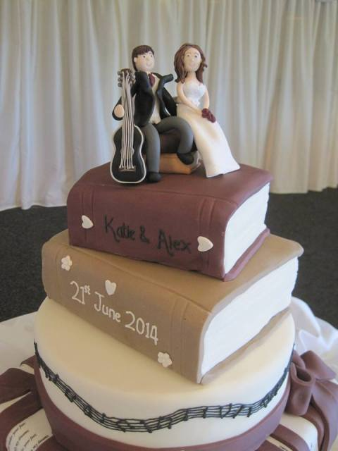 a cool books and guitar wedding cake