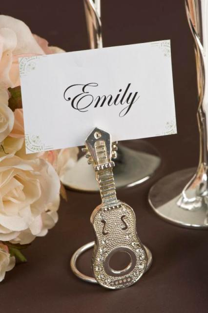 an embellished guitar card stand is a lovely and chic idea for a wedding tablescape