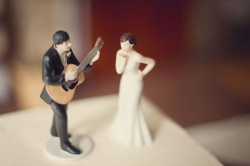 cool wedding cake toppers - a groom playing the guitar and a bride is a very whimsical idea