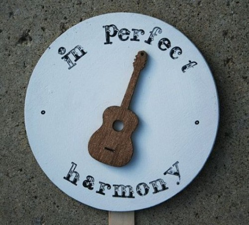 a sign with a wooden guitar is a cool and easy decoration for your wedding venue