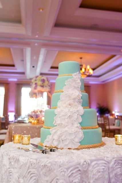 a tiffany blue wedding cake decorated with ropes and white orchids is a great option for a beach wedding