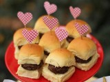 a red stand with burgers and red heart toppers is a cool idea for any wedding, perfect for a modern wedding