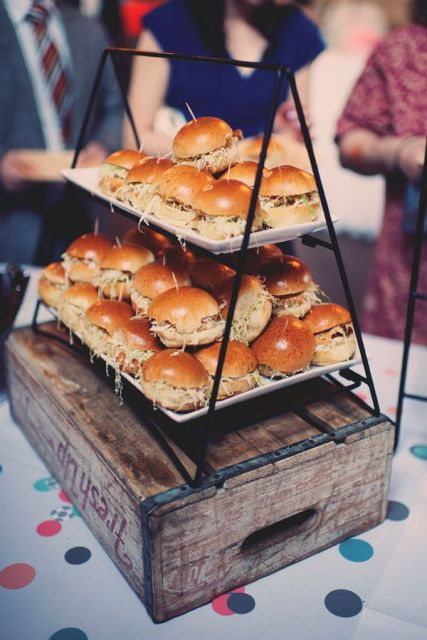 a wooden box with a black metal stand with lots of burgers will help you save some space and will make your guests happy