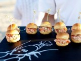 serve your crab and seafood burgers on a black tray with some corresponding pics and paintings