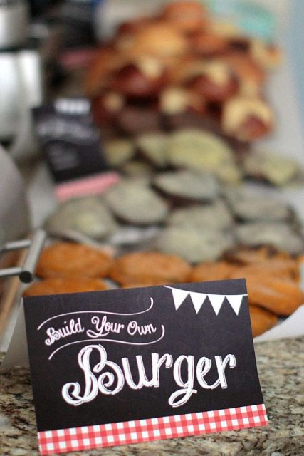 a burger making station with a chalkboard sign to mark that your guests can make what they love themselves