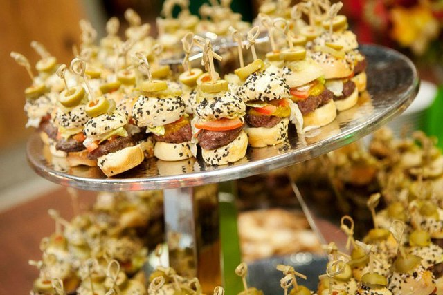 a whole stand with very mini burgers of various delicious stuff is a cool idea for a modern wedding