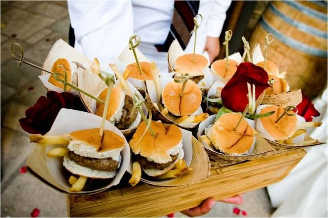 a wooden box with burgers in simple paper cones to make them more individual and easier to serve