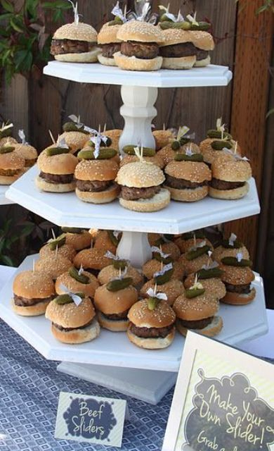 a simple white stand of wood with burgers on mini skewers is a great mini burger stand for any wedding