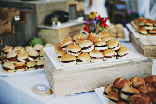 a rustic station with wooden boxes and trays and lots of mini burgers on skewers are a great idea for a farmhouse or just casual wedding