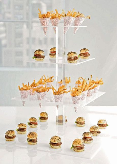 a sheer acrylic stand with mini burgers and paper cones with French fries is a perfect idea for a modern wedding
