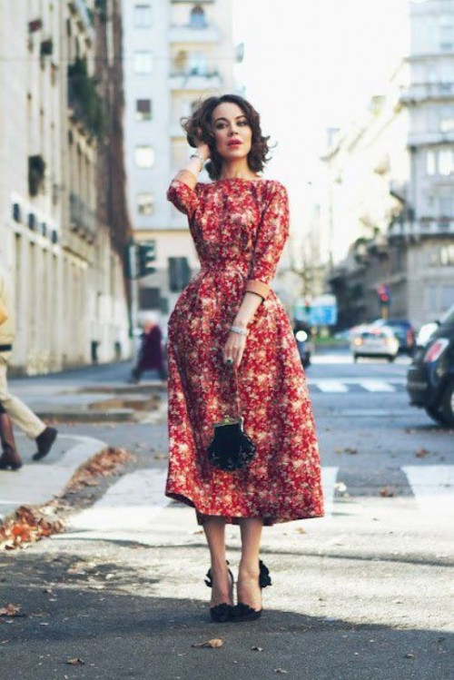 a red floral midi dress with an A-line silhouette, black shoes and a black bag is a trendy idea - florals are a hot idea