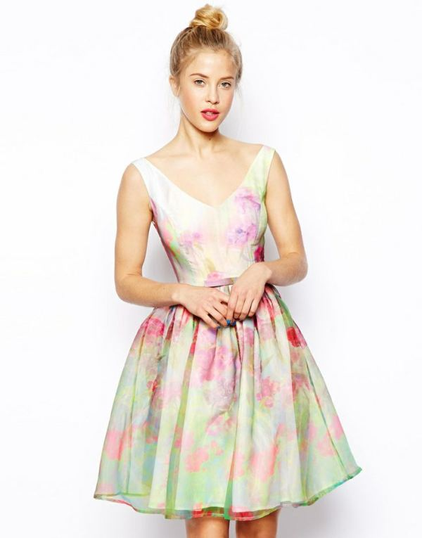 a pastel watercolor sleeveless A line short dress with a deep neckline looks and feels like spring