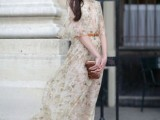 a flowy neutral floral maxi dress with a brown leather belt, vintage-inspired amber shoes and a brown clutch
