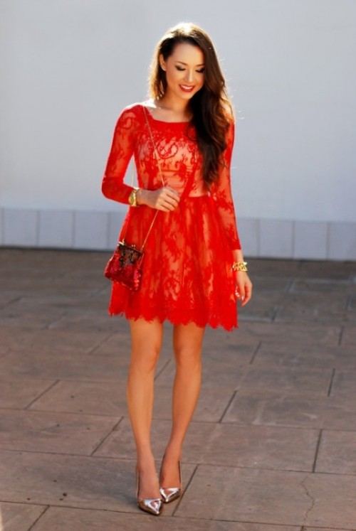 a red lace mini dress with a high neckline and long sleeves, metallic shoes and a mini red bag