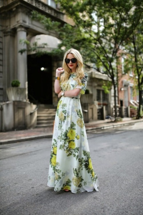 a green and yellow floral print maxi dress with short sleeves, statement accessories for a spring wedding