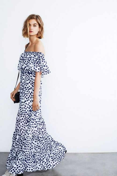 an off the shoulder black and white polka dot maxi dress, a black bag is classic monochrome for a modern spring wedding