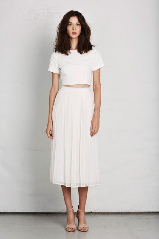 a casual white separate of a crop top with short sleeves and a midi skirt plus nude shoes for spring