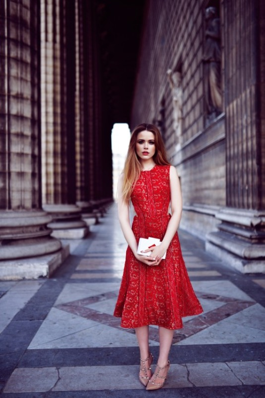 a red lace sleeveless A line midi dress, nude spiked shoes and a white box clutch for a romantic look