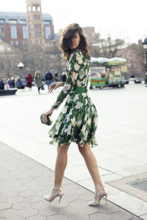 a green and white floral print short dress with a high neckline and long sleeves, silver shoes and a geometric clutch