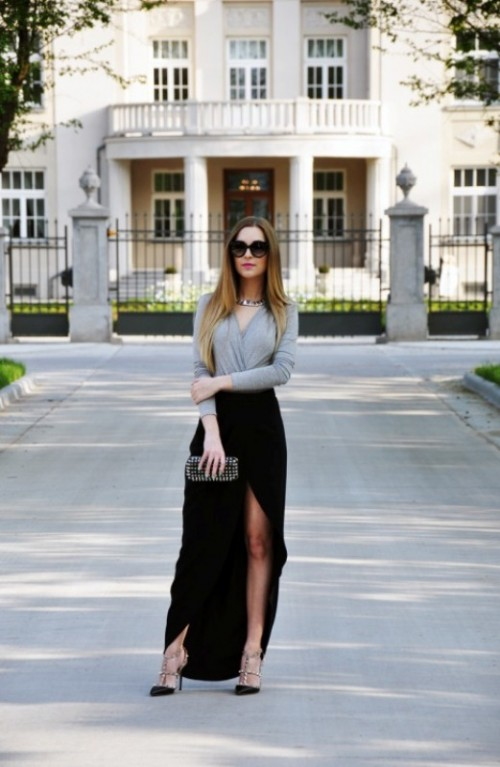 a grey long sleeve top, a black velvet wrap maxi skirt, black spiked shoes, a matching clutch and a statement necklace