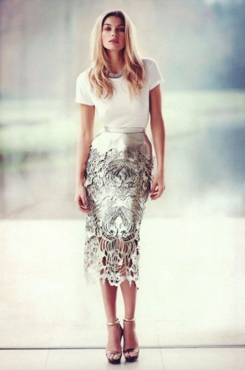 a white tee, a silver patterned cutout pencil midi skirt, a statement necklace and metallic shoes