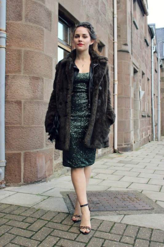 a green sequin sheath knee dress, a faux fur coat, leopard print shoes for a shiny and bold winter look