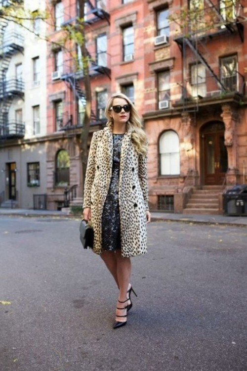 a black sequin A-line knee dress, an animal printed faux fur coat, black strappy shoes and a black bag