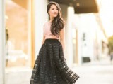 a pink sleeveless crop top, a black lace A-line midi skirt and minimalist black shoes