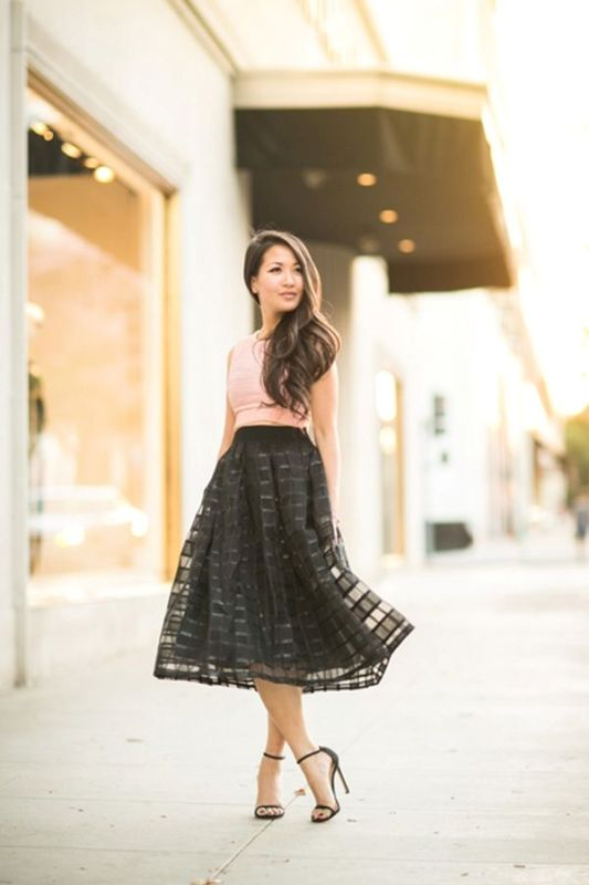 a pink sleeveless crop top, a black lace A line midi skirt and minimalist black shoes