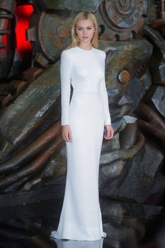 an ultra minimalist plain sheath wedding dress with a high neckline and long sleeves inspired by Lea's looks